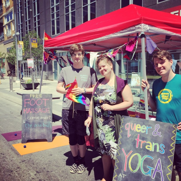 QSY community members promoting Queer & Trans Yoga at this year's Tri-Pride celebration in front of Kitchener City Hall! Photo Credit: @topherjohnb